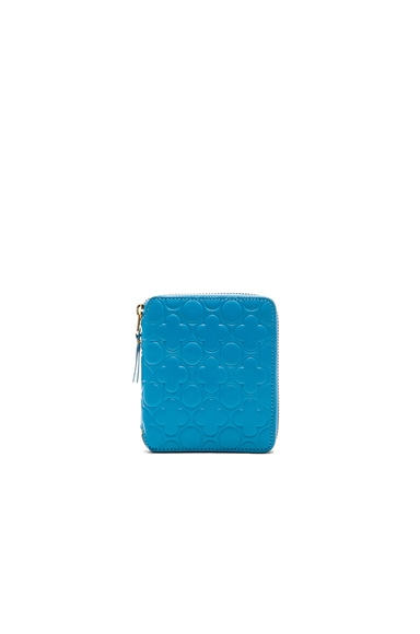 Comme Des Garcons Clover Embossed Zip Fold Wallet in Blue