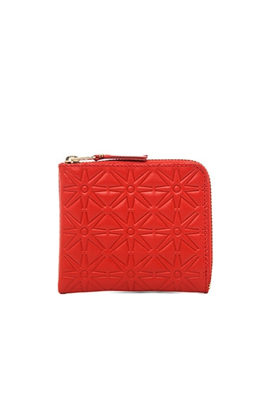 Comme Des Garcons Star Embossed Small Zip Wallet in Orange