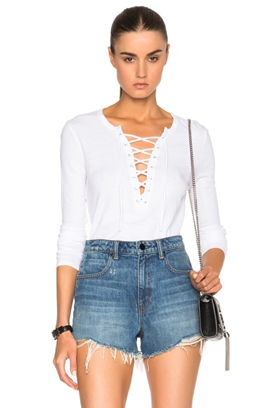 Pam & Gela Long Sleeve Lace Up Top in White