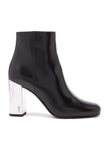 Saint Laurent Leather Babies Pin Boots in Black & Silver