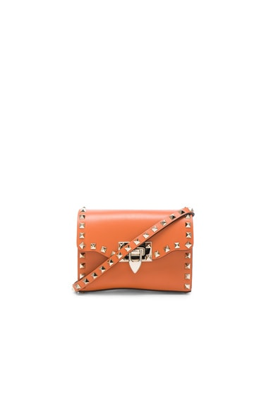 Valentino Small Rockstud Shoulder Bag in Orange