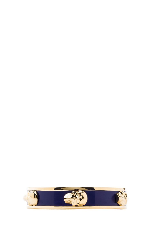 Image 1 of Alexander McQueen 3D Enamel Skull Bangle in Gold & Royal Blue