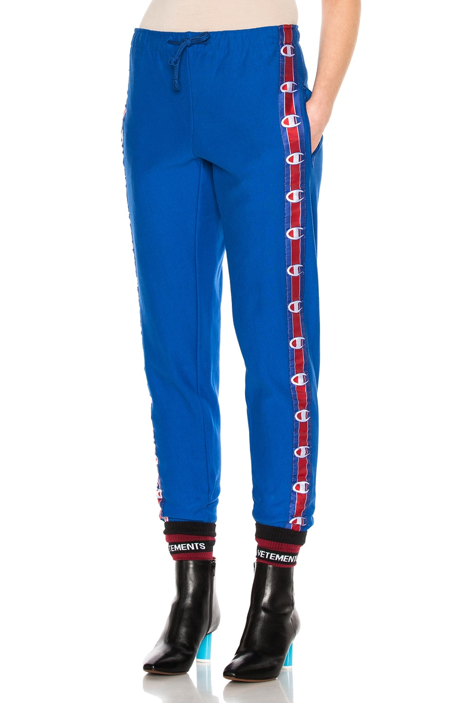 Image 1 of VETEMENTS x Champion Knee Shaped Tape Sweatpants in Blue