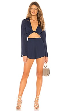 Claudia Twist Long Sleeve Romper About Us $64