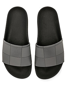 Adilette Checkerboard Slide adidas by Raf Simons $91