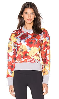 adidas by Stella McCartney Run Blossom Sweatshirt in Power Red & Radiant Orange