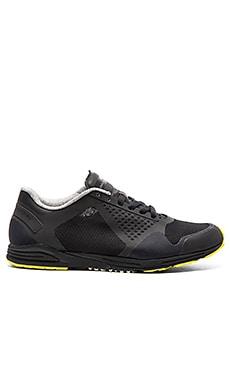 adidas by Stella McCartney Adizero Racing Sneaker in Core Black & Lime