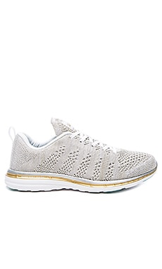 Athletic Propulsion Labs: APL Techloom Pro Sneaker in White, Silver & Gold