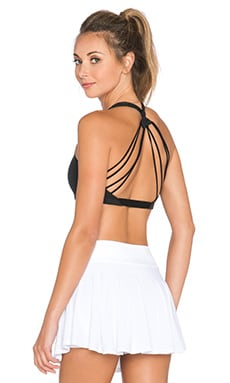 Beyond Yoga Strappy Twist Back Bra in Black