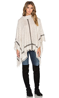 Bishop + Young Turtleneck Fringe Cape in Oatmeal