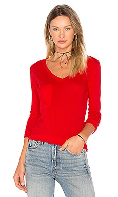 Light Weight Jersey Front Pocket Long Sleeve Top in Fierce