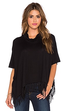 Central Park West Jackson Hole Turtleneck Fringe Poncho in Black