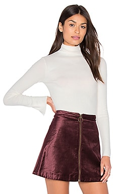 Enza Costa Long Sleeve Split Cuff Turtleneck Top in Winter White