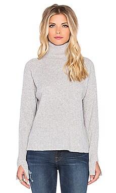 FRAME Denim Slit Turtleneck Sweater in Gris
