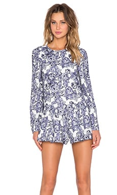 The Fifth Label Sound & Vision Long Sleeve Playsuit in Indigo Rose Print