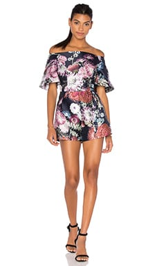 Stand Still Playsuit in Dark Floral Print