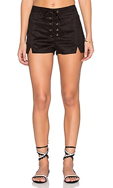 Faux Suede Lace Up Notched Shorts in Black