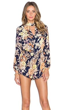 Lucca Couture Keyhole Long Sleeve Romper in Navy Floral