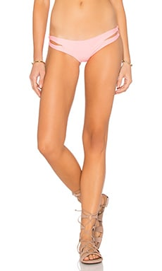 Luli Fama Cosita Buena Reversible Zig Zag Open Side Moderate Bottom in Pink Sunsets