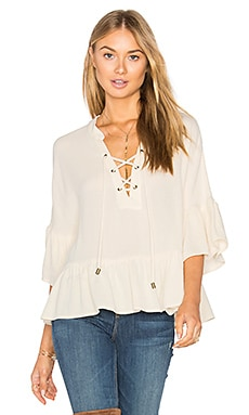 Lace Up Ruffle Top in Cream