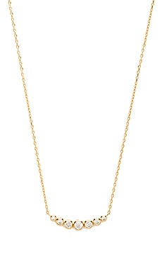 Michael Kors Graduated Round Cut Pendant Necklace in Gold & Clear