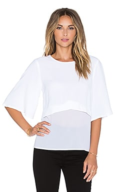 Minty Meets Munt Take Action Top in White