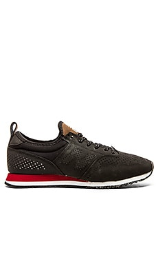 New Balance CM600 in Black Red
