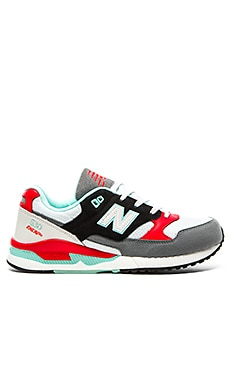 New Balance M530 in White Orange Black