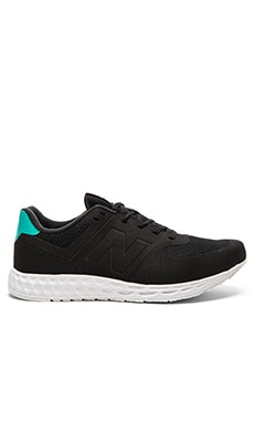 New Balance 574 in Black Green