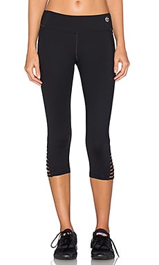Trina Turk Strappped Solids Mid Length Leggings in Black
