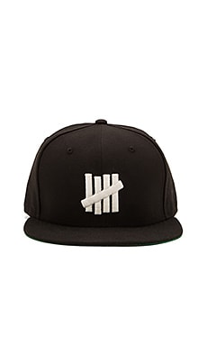 Undefeated 5 Strike Glow New Era Hat in Black