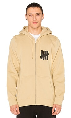 Undefeated Strike Vert Und Zip Hoodie in Tan