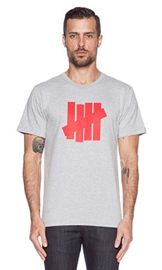 Undefeated 5 Strike Tee in Heather Red