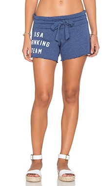 USA Drinking Team Shorts in City Night