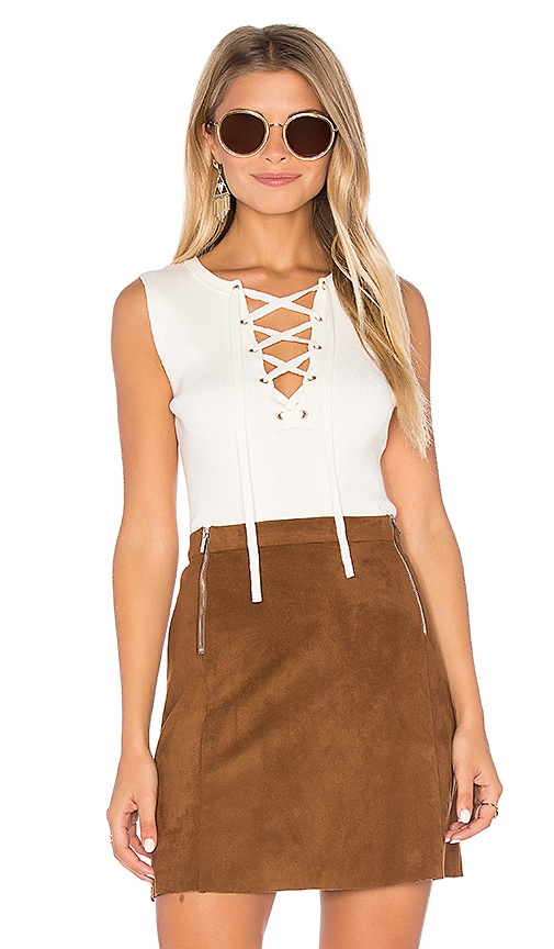 1. STATE Sleeveless Lace Up Sweater in Ivory