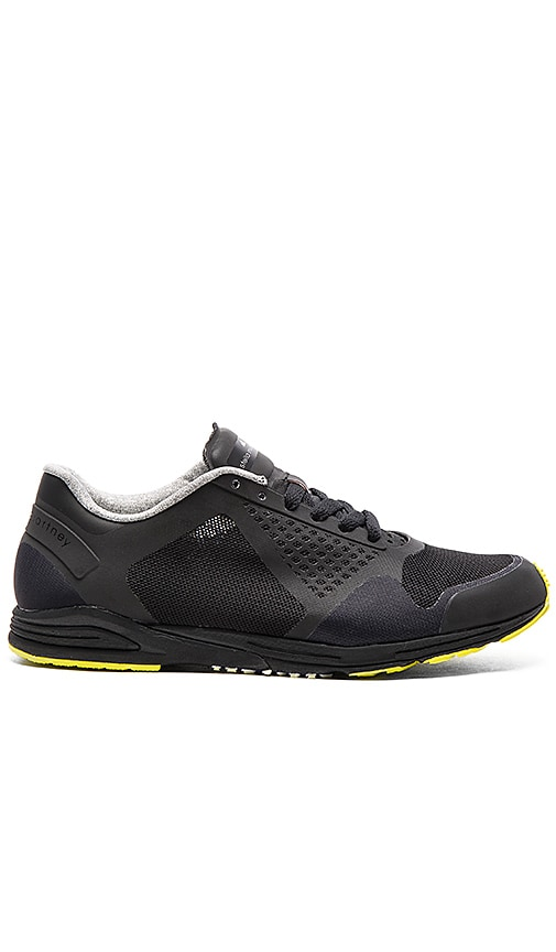 adidas by Stella McCartney Adizero Racing Sneaker in Core Black & Lime