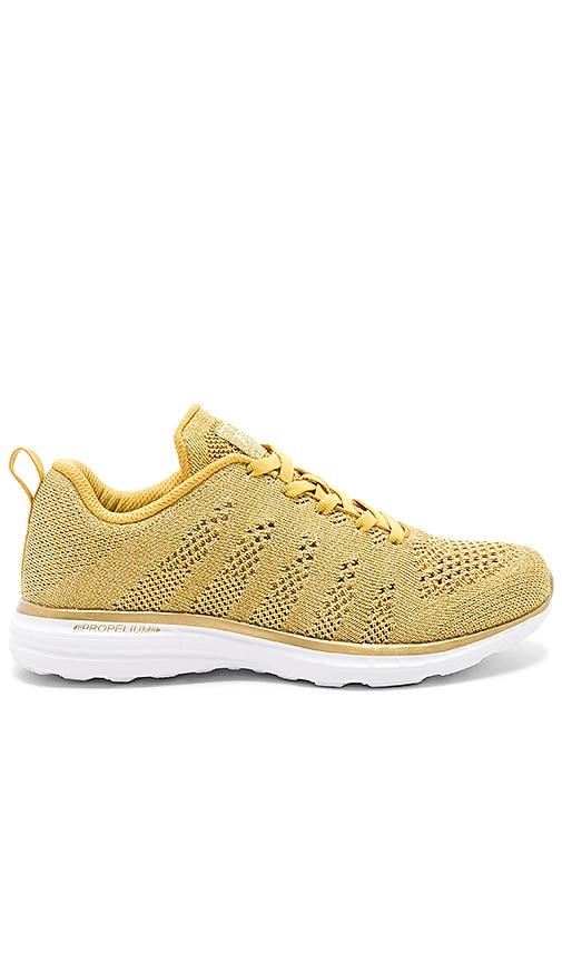 Athletic Propulsion Labs: APL Techloom Pro Sneaker in Metallic Gold