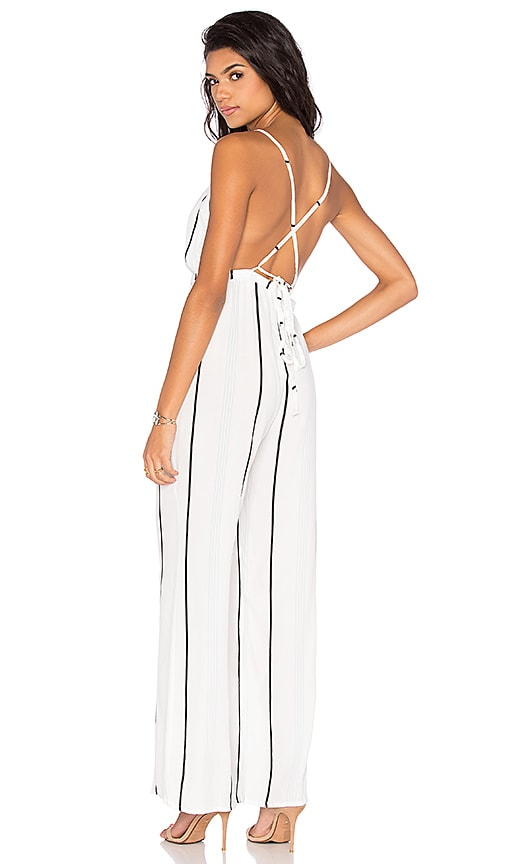 7cd6809d8b8 FAITHFULL THE BRAND Shutterbabe Jumpsuit in C est Stripe Print