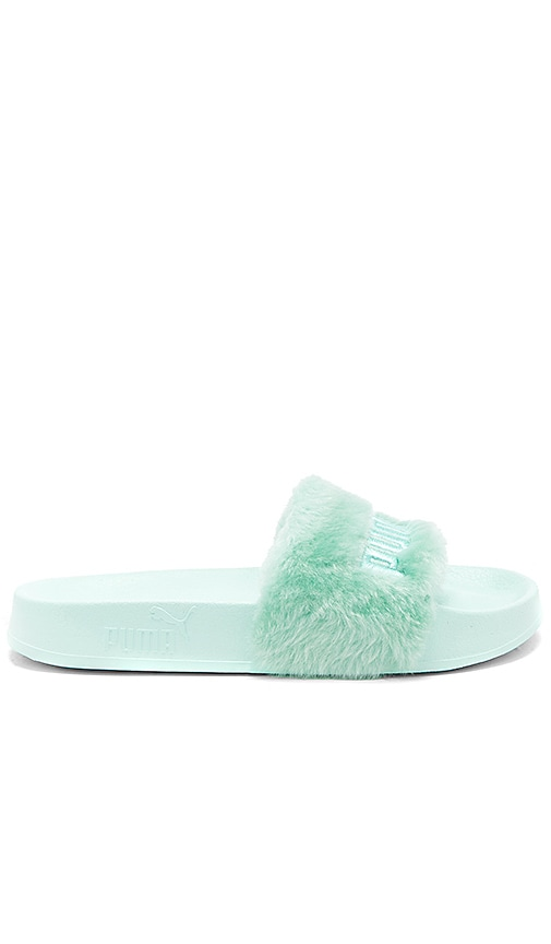 competitive price 40f86 41af0 Fenty by Puma Faux Fur Slide in Bay & Puma Silver | REVOLVE