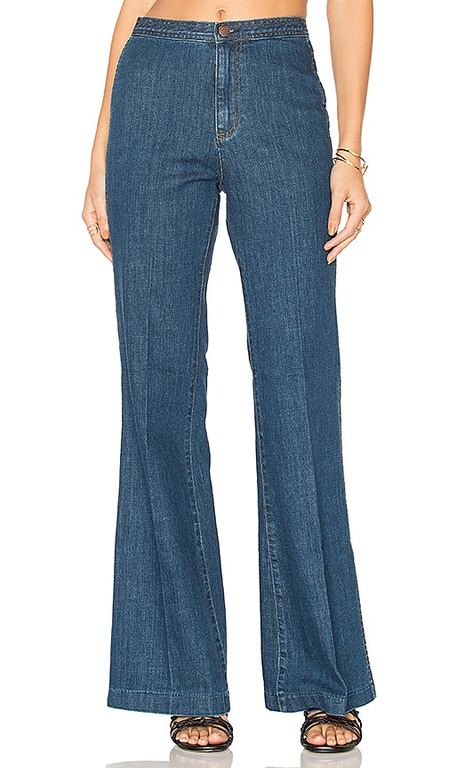 Free People Ray of Sunshine Flare Jeans in Dark Blue