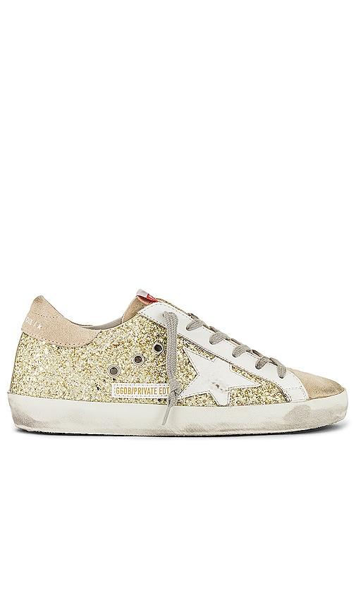 Golden Goose X REVOLVE Superstar Sneaker in Metallic Gold.