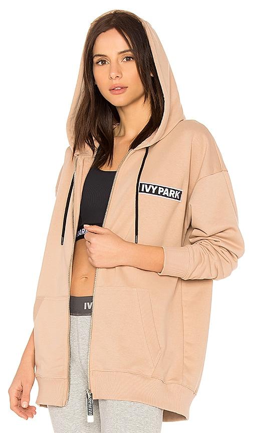IVY PARK Badge Logo Zip Up Hoodie in Cream