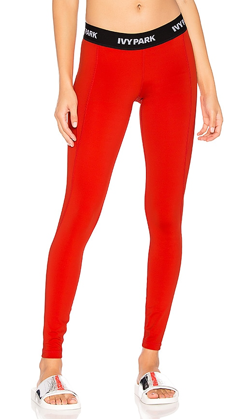 59f30a815adc0 IVY PARK Low Rise Legging in Tomato Red | REVOLVE