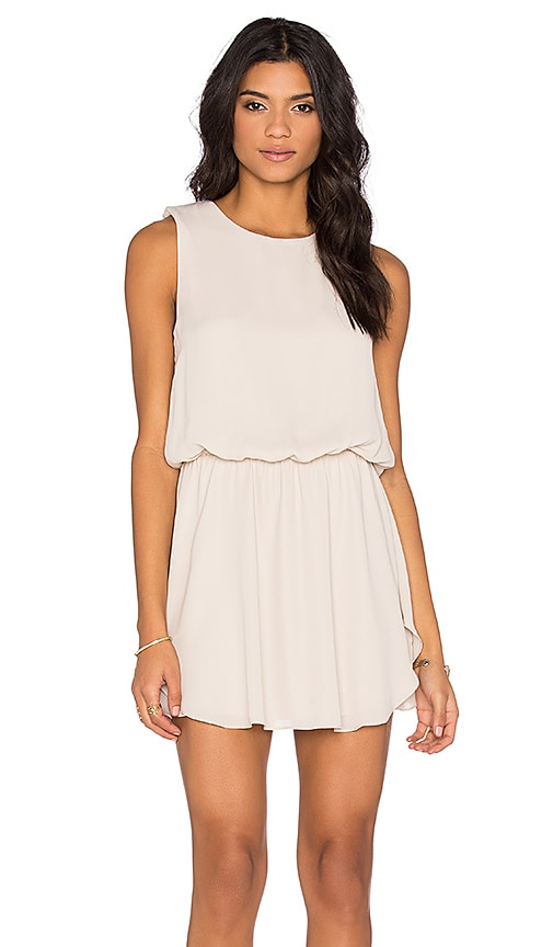 krisa Flounce Mini Dress in Beige