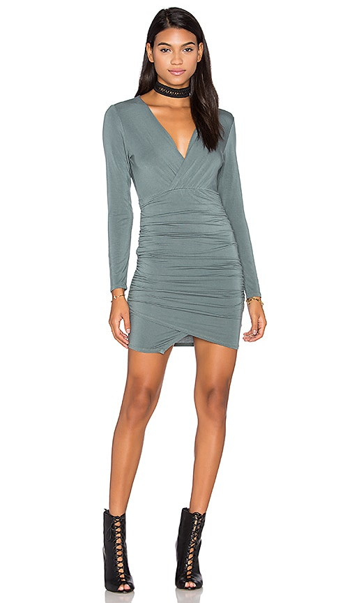 krisa Asymmetrical Surplice Mini Dress in Sage
