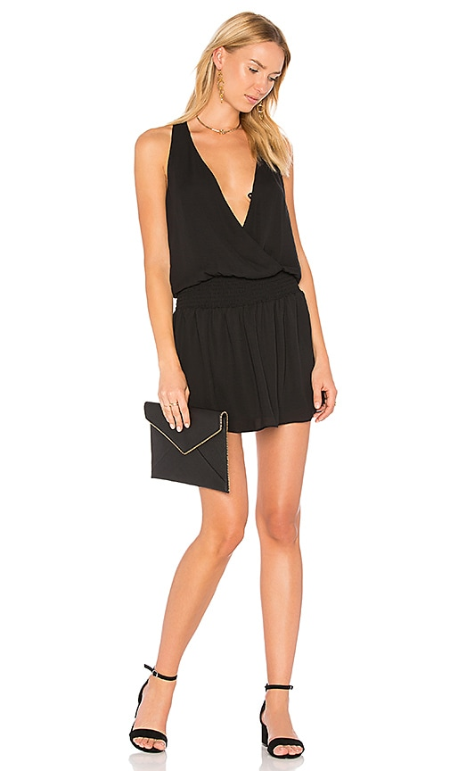 krisa Smocked Surplice Mini Dress in Black