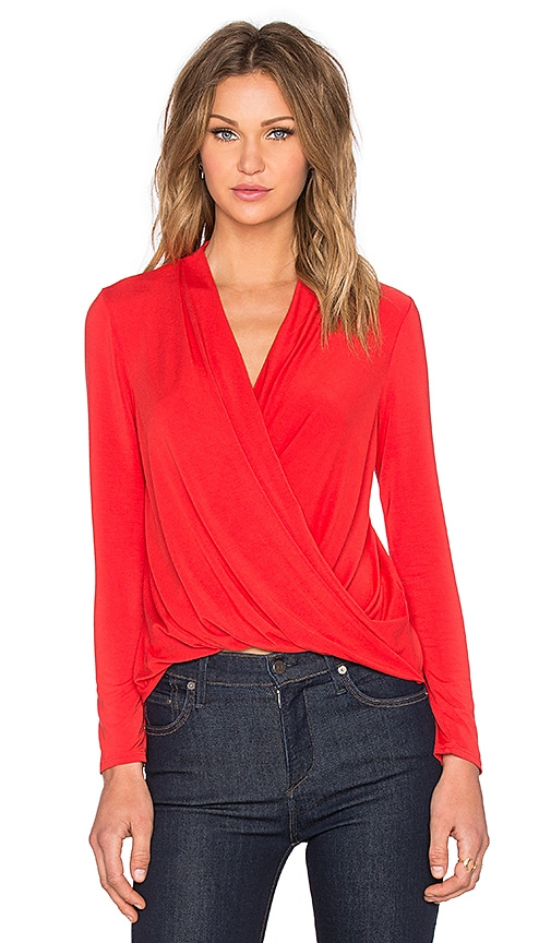 krisa Long Sleeve Surplice Top in Orange