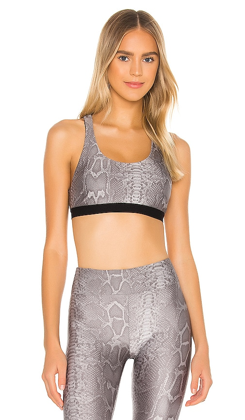 Tax Infinity Sports Bra by KORAL, available on revolve.com for $85 Abbey Clancy Top SIMILAR PRODUCT
