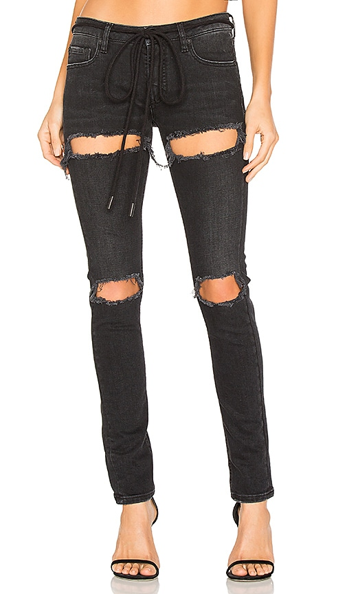 OFF-WHITE Ripped Skinny Jeans in Black