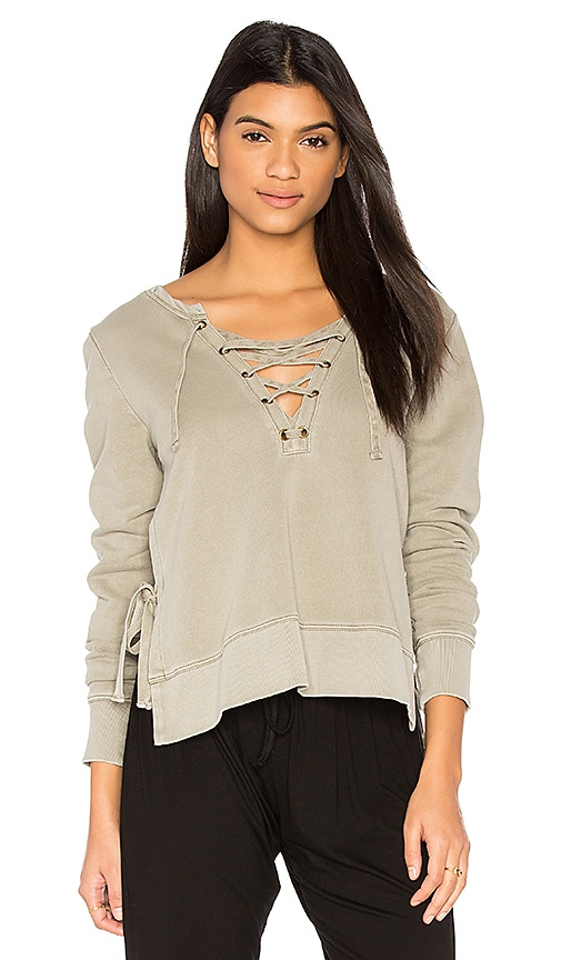 Pam & Gela Side Slit Lace Up Sweatshirt in Sage